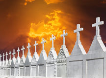 Many white crosses in graveyard on sunset Stock Photography