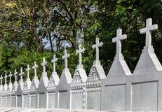 Many white crosses in graveyard. Stock Image