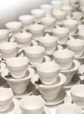 Many white cups for coffee and tea Stock Image