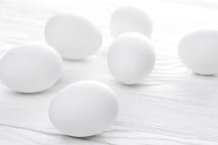 Many white eggs on the white Royalty Free Stock Photos