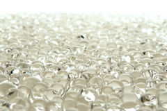 Many white gel marbles on white Stock Photo