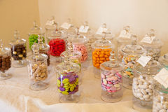 Sugared almonds. Many sugared almonds in the vases Royalty Free Stock Images
