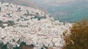 Many white houses are high in the mountains,panoramic view,Stunning beauty of the white villages of Andalusia in Spain. Many white houses are high in the stock video