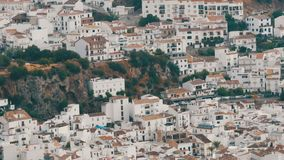 Many white houses are high in the mountains,panoramic view,Stunning beauty of the white villages of Andalusia in Spain. stock video footage