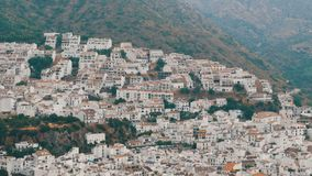 Many white houses are high in the mountains,panoramic view,Stunning beauty of the white villages of Andalusia in Spain. stock footage