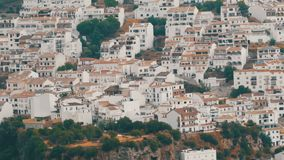Many white houses are high in the mountains,panoramic view,Stunning beauty of the white villages of Andalusia in Spain. Many white houses are high in the stock video footage