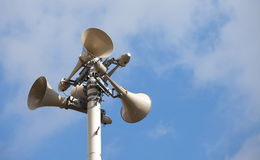 Many loudspeakers against cloudy blue sky Royalty Free Stock Images