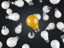 Many white and one green lightbulb on white background Royalty Free Stock Image