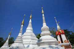 Many White pagodas in Mon style against blue sky Royalty Free Stock Photo