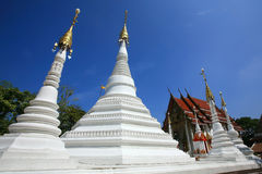 Many White pagodas and a temple against blue sky Stock Photography
