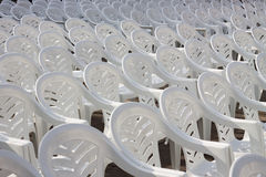 Many white plastic chairs Royalty Free Stock Photos