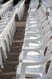 Many white plastic chairs Royalty Free Stock Image