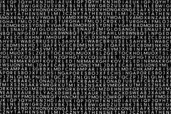 Many white sans alphabet letters. Stock Photos
