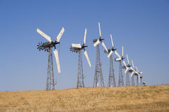 Many white wind turbine generating electricity Stock Images