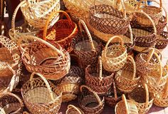 Many wicker baskets made from willow rods with hands made. Stock Images