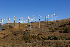 Many Wind Turbines on Hill Royalty Free Stock Photos