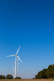Many wind turbines rotate Stock Images
