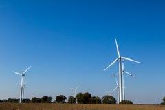 Many wind turbines rotate Stock Photos