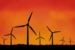 Many windmills as silhouette Stock Images