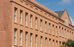 Many Windows in Brown Plaster Building Royalty Free Stock Photo