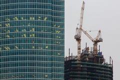 Many windows of skyscraper and construction Stock Photo