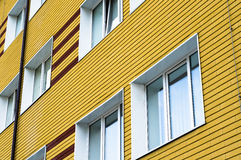 Many windows in yellow building Royalty Free Stock Image