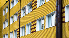 Many windows in yellow building Stock Photos