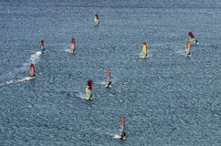Many windsurfers on the sparkling waves Stock Photography
