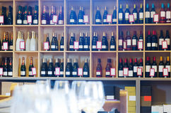 Many wine bottles in shelves of winery shop Stock Photo