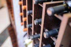 Many wine bottles on wine shelves. Resting on wooden racks in cellar. Interior in the restaurant Royalty Free Stock Photos