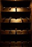Many wine bottles on a wooden shelf Royalty Free Stock Image