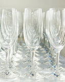 Many wineglasses stand in a line Royalty Free Stock Images