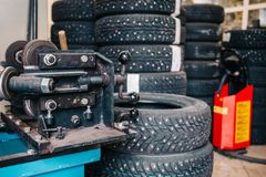 Many winter tires or car wheels in garage of repair service station, tire replacement concept Stock Photos