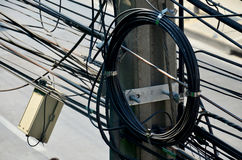 Many wires messy with power line cables, transformers and phone Royalty Free Stock Images