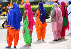 Many women with colorful dresses Royalty Free Stock Photo