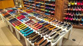 Many women`s shoes in the fashion store.  royalty free stock image