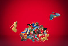 Many women's shoes. Many women's multicolored shoes. Big mountain footwear stock photos