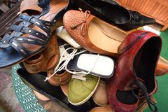 Many women shoes on a pile. In the summer royalty free stock photography