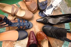 Many women shoes on a pile. In the summer royalty free stock images