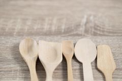 Many wood spoons lay on table. Many wood spoons lay on brown wood table for the food tool stock photos
