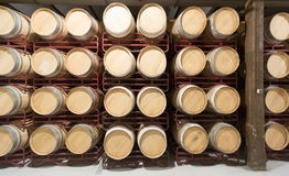 Many wooden barrels in rows Stock Photo