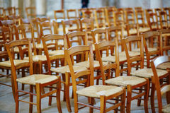 Many wooden chairs in church Stock Image