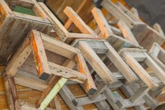 Many wooden chairs are lined up. royalty free stock photo
