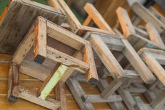 Many wooden chairs are lined up. stock photo