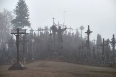 Hill of Crosses in the mist. royalty free stock photography