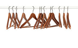 Many wooden hangers on a rod royalty free stock photos
