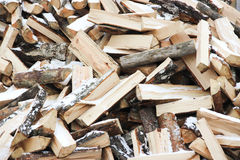 Many wooden logs in pile of snow-covered. Many wooden logs in the pile of snow-covered Royalty Free Stock Photos