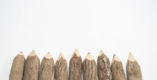 Many wooden pencils on white background. Many wooden pencils on the white background royalty free stock photo