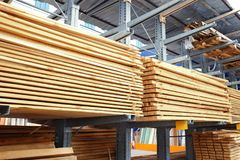 Many wooden planks. In hardware store stock photos