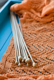 Many wooden spokes lie on an  knitted plaid Royalty Free Stock Image